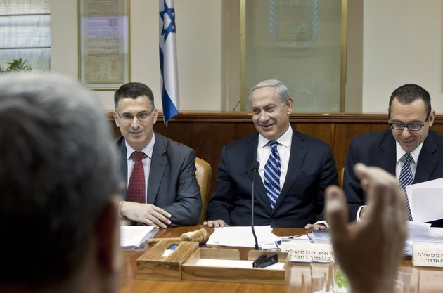 israeli-prime-minister-benjamin-netanyahu-second-right-laughs-as-defense-minister-ehud-barak-back-to-camera-makes-a-joke-that-netanyahu-should-give-fair-time-to-the-opposition-in-political-statements-as-netanyahu-chairs-the-weekly-cabinet-meeting-in-his-jerusalem-offices-sunday-oct-14-2012-israels-cabinet-announced-january-22-2013-as-the-date-for-parliamentary-elections-with-prime-minister-benjamin-netanyahu-leading-in-the-polls