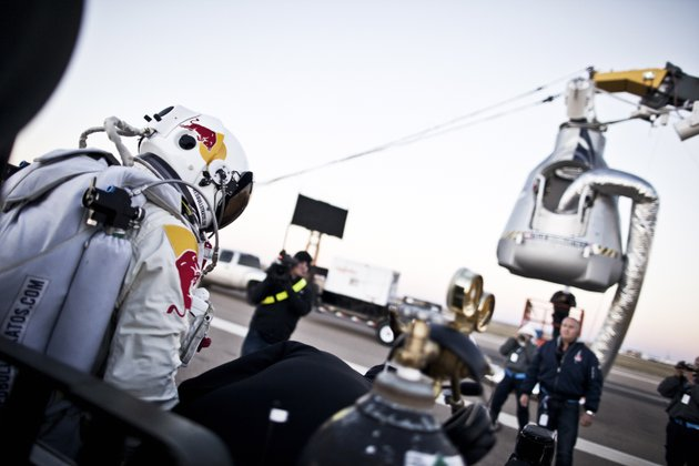 in-this-photo-provided-by-red-bull-pilot-felix-baumgartner-of-austria-steps-out-from-his-trailer-during-the-final-manned-flight-for-red-bull-stratos-in-roswell-nm-on-saturday-oct-14-2012-baumgartner-plans-to-jump-from-an-altitude-of-120000-feet-an-altitude-chosen-to-enable-him-to-achieve-mach-1-in-free-fall-which-would-deliver-scientific-data-to-the-aerospace-community-about-human-survival-from-high-altitudes
