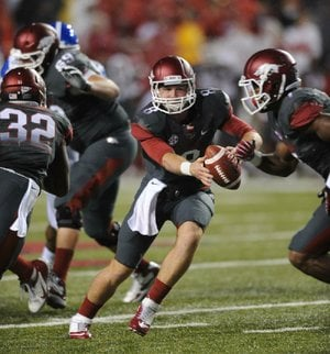 The Razorbacks will have to help their tackles to protect quarterback Tyler Wilson (shown) and the passing game against the LSU Tigers' talented pass rushers.