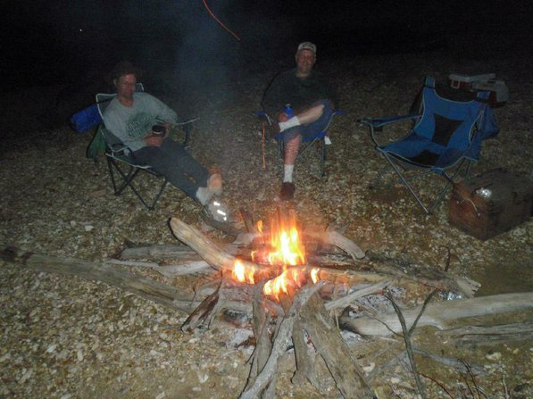 "Matt Hughes, left, and his brother, Mark ""Hog Ears"" Hughes, enjoy the night's campfire."