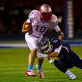 #10 QB Issac Jackson of Southside is tackled by #15 Drew Morgan of Greenwood during the first half.