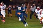 #11 QB Jabe Burgess of Greenwood keeps the ball and picks up a first down.