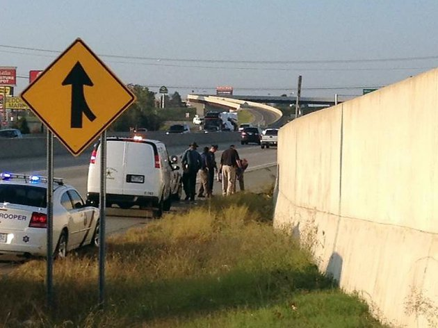 police-are-investigating-wednesday-oct-24-2012-after-a-body-was-found-on-the-side-of-us-67167-in-north-little-rock