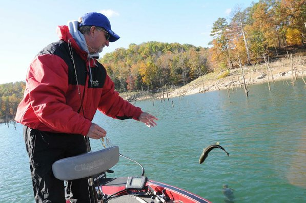 Brashers releases a bass he caught in the Big Clifty arm of Beaver Lake with a War Eagle spinner bait.