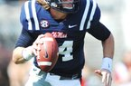 Ole Miss quarterback Bo Wallace is the player who keeps the Rebels' high-speed offense going for Coach Hugh Freeze.