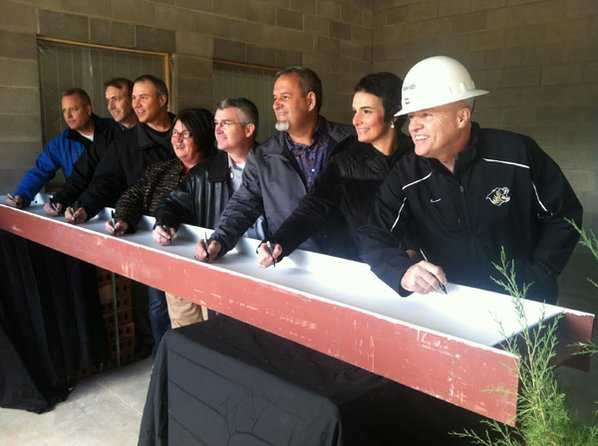 Bentonville school officials sign a ...