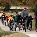 Cyclists make their way south along the newly opened section of the Razorback Greenway on Friday in ...