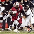 Deandre Murray, a Springdale running back, is stopped by a host of Bentonville defenders during the ...