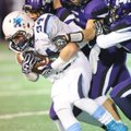 Tucker Lee, left, Springdale Har-Ber senior running back, carries the ball as Fayetteville senior li...