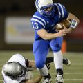 Nick Wary, Rogers starting quarterback, breaks a tackle by Siloam Springs linebacker Dolezal on a ca...