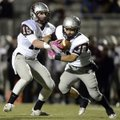 Austin Van Poucke, Siloam Springs starting quarterback, hands off to running back Scout Alexander du...