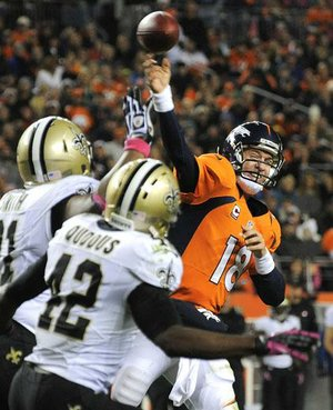 Denver Broncos quarterback Peyton Manning threw for 305 yards and three touchdowns in a 34-14 victory over the New Orleans Saints on Sunday night.