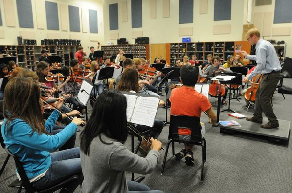 Jesse Collett, orchestra director, conducts a practice at Bentonville High School.