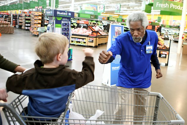 chase-varner-left-gives-willie-perkins-a-bam-on-the-way-out-of-walmart-in-maumelle-mr-willie-as-he-is-known-by-some-customers-is-a-greeter-at-the-store-who-is-famous-for-his-high-energy-and-fist-bumps