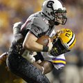 LSU defensive end Sam Montgomery sacks South Carolina quarterback Connor Shaw (14) during the second...