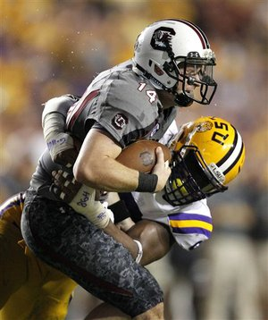 LSU defensive end Sam Montgomery sacks South Carolina quarterback Connor Shaw (14) during the second half of an NCAA college football game in Baton Rouge, La., Saturday, Oct. 13, 2012. LSU won 23-21. (AP Photo/Gerald Herbert)