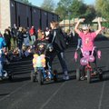 Alicia Billis, right, cheers to get her teacher tricycle-racing team ready to ride Wednesday at Tenn...