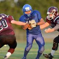 Samuel Xiong, right, a Decatur running back is chased down by Gentry's Dustin Soufflet, left, and Da...