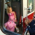 Katherine Bailey, 4, from Fayetteville, gets a little help Wednesday from Fayetteville firefighter M...