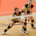 Hailey McNee, left, of Bentonville digs a ball hit by North Little Rock on Wednesday as Sabrina Shep...