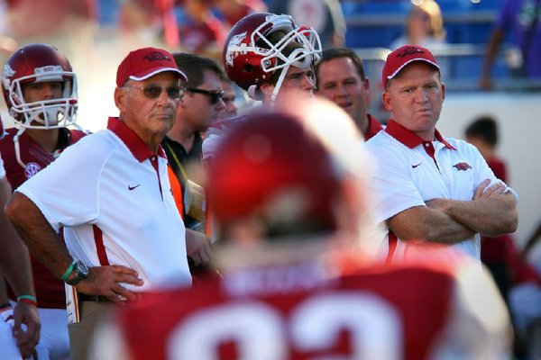 Arkansas offensive coordinator Paul Petrino (right) told the Northwest Arkansas Touchdown Club on Wednesday that coaches had told game officials during the Ole Miss game that the Razorbacks would be running a play where they would move a lineman out on the field. Despite the advance warning, Arkansas was penalized on the play, which negated a touchdown pass to Austin Tate.