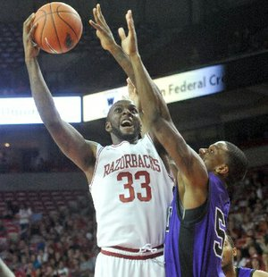 NWA Media/ MICHAEL WOODS --11/02/2012 -- University of Arkansas forward Marshawn Powell goes up for a lay up over Southwest Baptist defender Jaywuan Hill as he drives to the hoop in the first half of Friday night's game at Bud Walton Arena in Fayetteville.