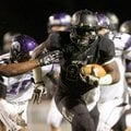 STAFF PHOTO JASON IVESTER -- Bentonville senior running back Tearris Wallace breaks through the Faye...