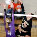 Hailey McNee, Bentonville senior, tries to send a shot past Fayetteville senior Aubrey Edie during t...