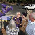 Longtime Eureka Springs artist Zeek Taylor, center, is greeted Oct. 4 by friends and patrons Cheryl ...