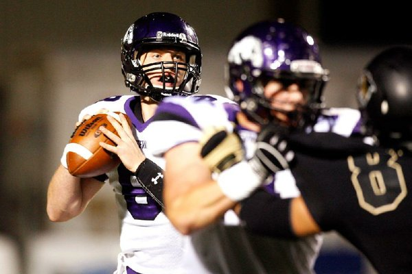 Fayetteville quarterback Austin Allen looks for a receiver in the first half of a 24-17 loss to top ranked Bentonville on Friday at Tiger Stadium in Bentonville. Allen threw for 194 yards.