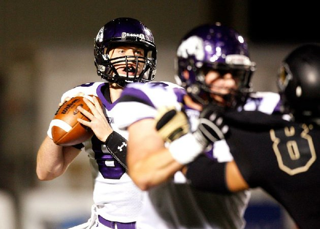 fayetteville-quarterback-austin-allen-looks-for-a-receiver-in-the-first-half-of-a-24-17-loss-to-top-ranked-bentonville-on-friday-at-tiger-stadium-in-bentonville-allen-threw-for-194-yards