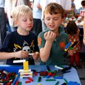 Will Russell, left, and Drew Lawrence, both 5 and of Rogers, play with toys Friday during First Frid...