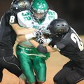Evan Johnson, Greenland senior tailback, is hit Friday by West Fork sophomores James Wil Young, left...