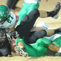 Wyatt Montgomery, center, West Fork running back, is brought down Friday by Greenland linebacker Kay...