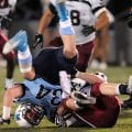 Neal Parson, right, Springdale High, rolls Tucker Lee of Springdale Har-Ber over on a tackle Friday ...