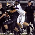 Alex Brignoni, a Fayetteville senior defensive back, brings down Bentonville senior running back Gar...