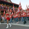 Members of the University of Arkansas Marching Band lead the homecoming parade Friday up Dickson Str...