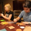 Maria Rossetti, 17, right, and Katie Morton, 10, demonstrate Wednesday the work members of the Unite...