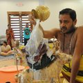 Sri Swami Venugopalla Gattu pours milk over a stature of the goddess Durga during a ceremony Oct. 20...