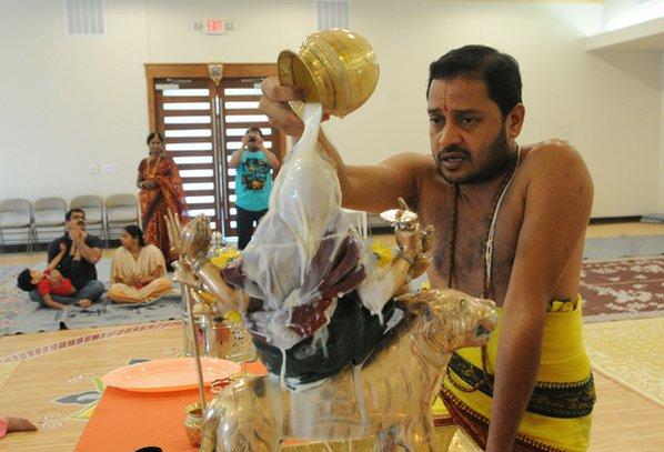Sri Swami Venugopalla Gattu pours ...