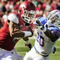 Arkansas wide receiver Julian Horton (2) tries to get around Tulsa defensive back Marco Nelson (20) ...