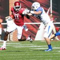 Arkansas receiver Cobi Hamilton (11) tries to fend off Tulsa defender Mitchell Osborne as he runs fo...