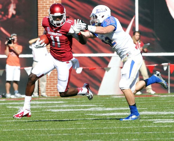 Arkansas receiver Cobi Hamilton (11) ...