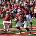 Running back Dennis Johnson (33) scores Arkansas' first touchdown, an 8-yard run in the first quarte...
