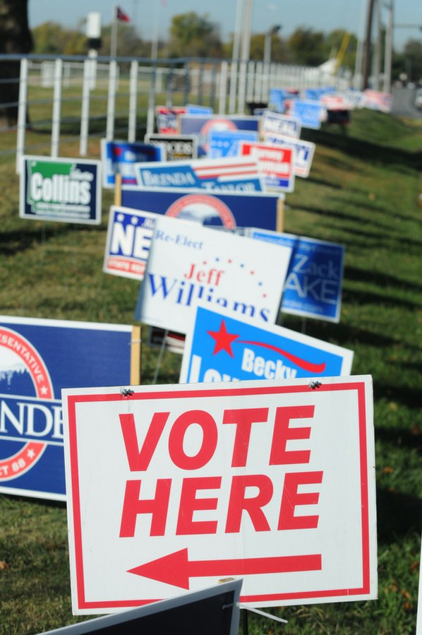 "A ""Vote Here"" sign is ..."