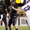 Reese Dollins, Bentonville senior quarterback, passes Friday against Fayetteville at Tiger Stadium i...