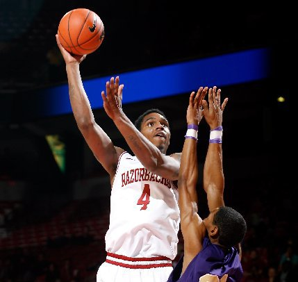 nwa-mediajason-ivester-arkansas-junior-coty-clarke-attempts-a-hook-shot-over-lemoyne-owen-junior-victor-shell-during-the-first-half-on-monday-nov-5-2012-at-bud-walton-arena-in-fayetteville