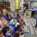 Carlena Lambert works with music students Friday afternoon at Asbell Elementary School in Fayettevil...