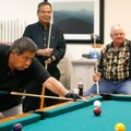 Alex Simon of Springdale and Gene McClure of Rogers, right, watch as Al Poolaw, left, of Rogers, lin...