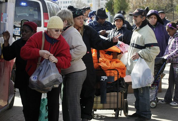 Residents line up for bundles ...